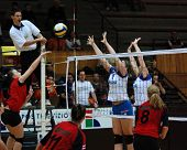 KAPOSVAR, HUNGARY - MARCH 4: Zsanett Pinter (L) strikes the ball in the Hungarian Championship woman volleyball game Kaposvar vs Vasas, March 4, 2007 in Kaposvar, Hungary.