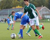 KAPOSVAR, HUNGARY - SEPTEMBER 29: Bence Kovacs (in green) in action at the Hungarian National Championship under 17 game between Kaposvari Rakoczi and Komlo September 29, 2010 in Kaposvar, Hungary.
