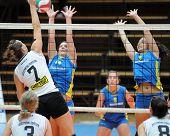 KAPOSVAR, HUNGARY - OCTOBER 10: Dora Ihasz (14) blocks the ball at the Hungarian NB I. League woman volleyball game Kaposvar vs Veszprem, October 10, 2010 in Kaposvar, Hungary.