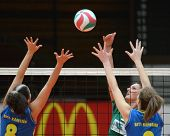 KAPOSVAR, HUNGARY - NOVEMBER 14: Barbara Balajcza (L) blocks the ball at the Hungarian NB I. League