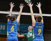 KAPOSVAR, HUNGARY - NOVEMBER 14: Rebeka Rak (R) blocks the ball at the Hungarian NB I. League woman