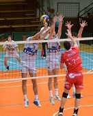 KAPOSVAR, HUNGARY - NOVEMBER 25: Krisztian Csoma (14) blocks the ball at the CEV Cup volleyball game
