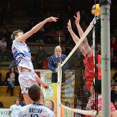 KAPOSVAR, HUNGARY - NOVEMBER 25: Krisztian Csoma (L) strikes the ball at the CEV Cup volleyball game