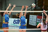 KAPOSVAR, HUNGARY - DECEMBER 12: Rebeka Rak (C) in action at the Hungarian NB I. League woman volley