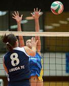 KAPOSVAR, HUNGARY - JANUARY 14: Zsofia Harmath (R) blocks the ball at the Hungarian NB I. League woman volleyball game Kaposvar vs Ujbuda, January 14, 2011 in Kaposvar, Hungary.