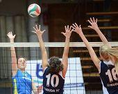 KAPOSVAR, HUNGARY - JANUARY 14: Zsanett Pinter (L) strikes the ball at the Hungarian NB I. League woman volleyball game Kaposvar vs Ujbuda, January 14, 2011 in Kaposvar, Hungary.