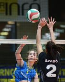 KAPOSVAR, HUNGARY - JANUARY 23: Rebeka Rak (L) strikes the ball at the Hungarian NB I. League woman