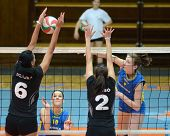 KAPOSVAR, HUNGARY - JANUARY 23: Zsanett Pinter (R) strikes the ball at the Hungarian NB I. League wo