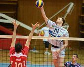 KAPOSVAR, HUNGARY - FEBRUARY 20: Krisztian Csoma (14) strikes the ball at a Middle European League v