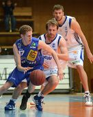 KAPOSVAR, HUNGARY - FEBRUARY 26: Joshua Wilson (C) in action at a Hungarian National Championship ba
