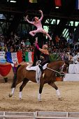 KAPOSVAR, HUNGARY - AUGUST 12: Austrian team in action at the Vaulting World Championship Final on A