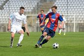 KAPOSVAR, HUNGARY - APRIL 20: Attila Polonkai (R) in action at a Hungarian National Cup soccer game