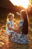 Mother Daughter Time. Portrait Of Mother And Daughter At Nature Sitting And Looking At Itch Other. M poster