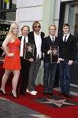 LOS ANGELES - FEB 6: Destry; Dewey Bunnell; Matt; Gerry Beckley; son Joe at a ceremony where their rock band 'America' in honored with a star on the Hollywood Walk of Fame in Los Angeles, California. Feb 6, 2012