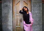 Asian Woman Infront Of Door