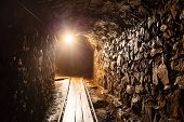 stock photo of catacombs  - Mine tunnel with path  - JPG