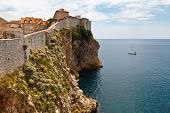 Yacht Approaching Impregnable Walls Of Dubrovnik, Croatia