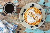 Fathers Day Pancakes With Heart Shape And Dad Letters. Fathers Day Breakfast Concept. Top View On A  poster