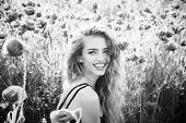 Pretty Woman Or Happy Smiling Girl With Long Curly Hair Hold Flower In Field Of Red Poppy Seed With  poster