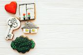 Moving In New House, Welcome Home Set. Key, House, Plant,heart, Welcome Sign Cookies On White Wood,  poster