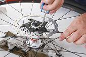 cyclist/biker taking care of his bike