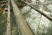 Rope bridge hanging over mountain river