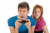 Boy is excitement about playing the computer game when is girlfriend is looking exciting