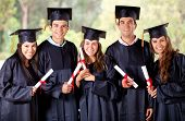 stock photo of graduation  - Happy group of students in their graduation smiling - JPG