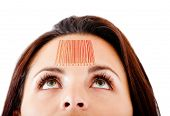 Woman with a barcode in her forehead selling knowledge - isolated over white