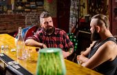 Friends Relaxing In Bar Or Pub. Hipster Bearded Man Spend Leisure With Friend At Bar Counter. Men Re poster