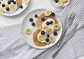 Healthy Summer Breakfast. Homemade Oatmeal Pancakes With Yogurt, Fresh Blueberry And Banana At White poster