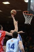 KAPOSVAR, HUNGARY - JANUARY 28: Nik Raivio (with ball) in action at a Hungarian Championship basketb
