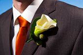 Close Up Of A Lily Corsage On A Groom