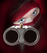 Terrorist or gangster with shotgun aimed at you. Close up with shallow DOF.