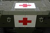 pic of armored car  - Red cross sign on armored military transporter - JPG