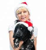 smiling woman and dog in santa hat at Christmas