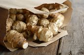 stock photo of jerusalem artichokes  - Jerusalem artichoke in a paper bag - JPG