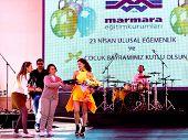 Pop star Atiye with headmaster on the concert ceremony