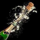 Celebration event with concept of dollar bank-notes splashing out of bottle. Isolated on black background