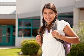 Cute Hispanic Teen Girl Student with Backpack Ready for School.