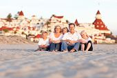 Happy Caucasian Family in Front of Hotel Del Coronado, U.S.A. on a Sunny Afternoon.