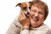 Happy Attractive Senior Woman with Puppy Isolated on a White Background.