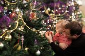 Baby Touching Bulb On Christmas Tree