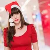 confused woman wearing a christmas hat, indoor