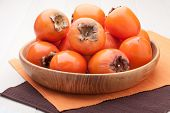 Exotic Tropic Orange Fruits Persimmon Served In Wooden Plate
