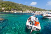 VIS, CROATIA - JULY 7, 2012: People in the boat on July 7, 2012 in Vis, Croatia. Local people are sh
