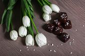 White Tulips with Sated Chocolate Candies