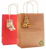 Two Gift Bags Made Fo Recycled Paper, Decorated With Natural Wood Ornaments