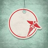 image of serpent  - Caduceus medical symbol with text space on grungy green background - JPG
