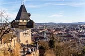 the clock tower is the landmark of the city of graz. capital of styria in austria poster